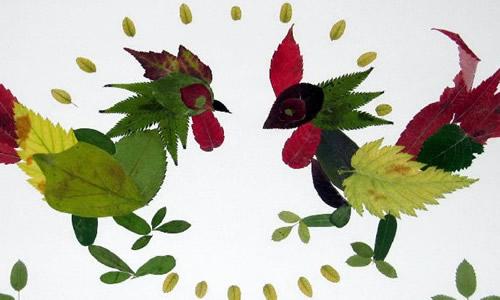 我看看小伙伴们的树叶贴画,有拼成金鱼的,有拼小兔的,还有拼蝴蝶的.
